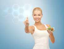 Woman with salad and virtual screen Royalty Free Stock Photography
