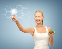 Woman with salad and virtual screen Royalty Free Stock Photos