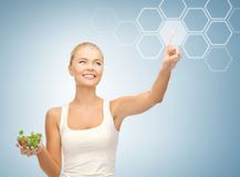 Woman with salad and virtual screen Royalty Free Stock Image