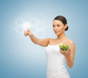 Woman with salad and virtual screen Royalty Free Stock Images