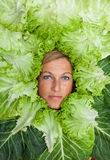 Woman with salal leafes around her head. Stock Photo