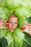 Woman with salal leafes around her head. Royalty Free Stock Photos