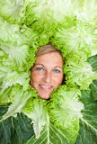 Woman with salal leafes around her head. Stock Images