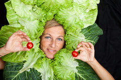 Woman with salal leafes around her head. Royalty Free Stock Photography