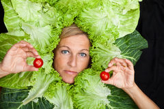 Woman with salal leafes around her head. Royalty Free Stock Photo