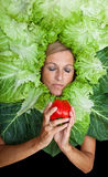 Woman with salal leafes around her head. Royalty Free Stock Image