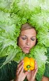 Woman with salal leafes around her head. Stock Photography