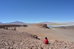 Woman at the Salar de Tara salt lake in Atacama Desert, Bolivia