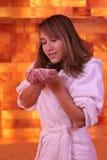 Woman in salarium deep breath with salt royalty free stock photography