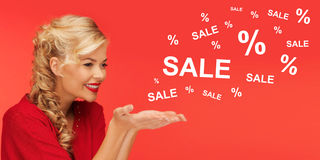 Woman with sale and percentage signs over red Royalty Free Stock Photo