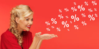 Woman with sale and percentage signs over red Royalty Free Stock Photos