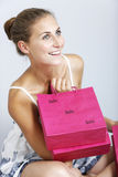 Woman with sales bags Royalty Free Stock Images