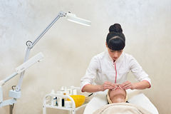 Woman in salon Stock Images