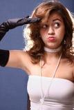 Woman saluting Stock Photo