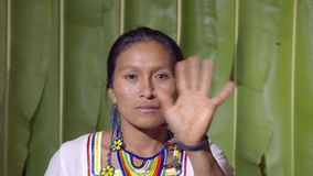 Woman Saluting The Viewer. In The Sense Of Goodbye In Ecuador stock video footage