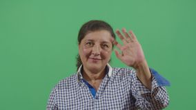 Woman Saluting The Viewer. In The Sense Of Goodbye In Ecuador stock footage