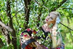 Woman samurai near blossoming tree Royalty Free Stock Photo