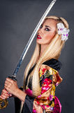 Woman with samurai sword Royalty Free Stock Image