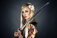 Woman with samurai sword. Portrait of a woman with samurai sword Royalty Free Stock Photography