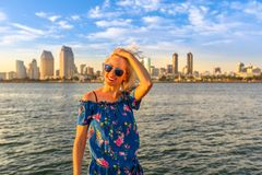 Woman at San Diego. Happy tourist woman enjoying at San Diego Downtown skyline with skyscrapers in California, USA from Coronado Island. Summer holidays in stock photos