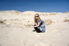Woman in Sand Stock Photos