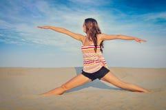 Woman on the sand Stock Photos