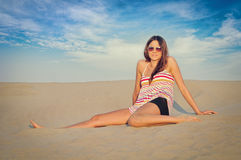 Woman on the sand Royalty Free Stock Photography