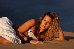 Woman on sand Stock Photography