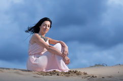 Woman on a sand dune Stock Photography