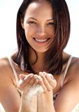 Woman with sand falling through fingers Stock Images