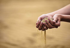 Woman with sand in hands Royalty Free Stock Images