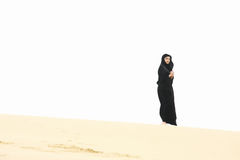 Woman on sand hill crest Royalty Free Stock Images