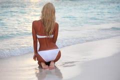 Woman on the sand the ocean coast Stock Photography