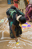 Woman sand  painting Stock Photo