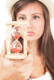 Woman with sandclock Stock Photography