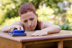 Woman is sanding by hand Royalty Free Stock Image