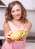 Woman with sandwich Royalty Free Stock Photos