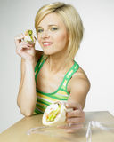 Woman with sandwich Stock Images