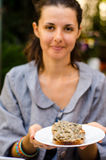 Woman with sandwich. Smiling vegetarian woman with mushroom sandwich royalty free stock image