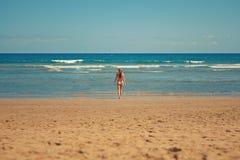 Woman on sandy beach
