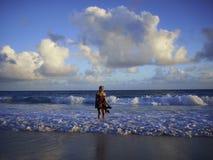 Woman on a sandy beach on a cloudy day Stock Photo