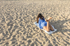 Woman on a sandy beach Stock Photo