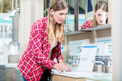 Woman in sanitary goods department of hardware store Stock Photo