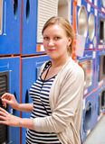 Woman in sanitary shop. Royalty Free Stock Photography