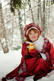 Woman-santa. Female santa claus with gift in hands Royalty Free Stock Image
