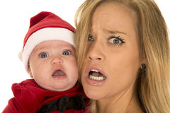Woman and santa baby upset Royalty Free Stock Photography