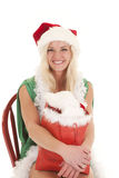 Woman santa bag smile Stock Photos