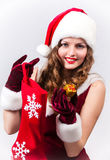 Woman Santa with a big gift Stock Photos