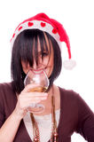 Woman with Santa cap drinking wine Royalty Free Stock Photo