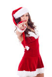 Woman in Santa Cap pointing Stock Photo